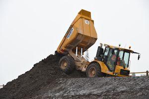 2. Dump truck tipping soil
